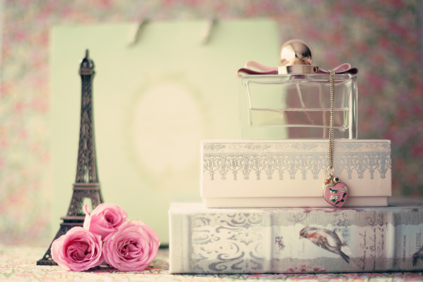 Eiffel tower with roses and perfume bottle